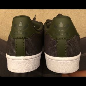 adidas Shoes - Brand new with tags dark green adidas superstars